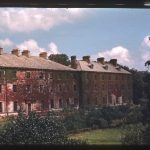 Photograph of a block of brick buildings: St. Mary's Hall, from 1830