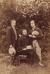 Photograph of Hopkins seated with two friends